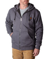 man in dark gray zip up hoodie