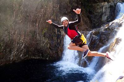 Man jumping off a waterfall