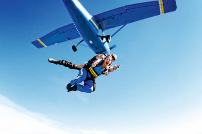 Girl jumping out of a plane while skydiving
